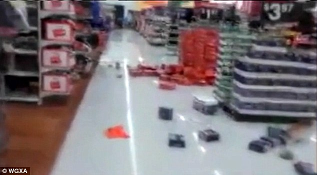 Horrible: 50 teenagers in Macon, Georgia stormed at Walmart at 2am on Sunday after a night of partying (destruction pictured above)