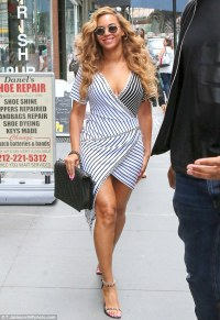 Beyonce accentuates her curves in a striped wrap dress in ...