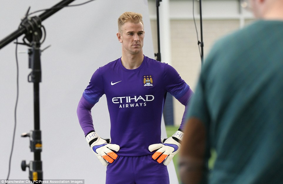 Manchester City goalkeeeper places his hands on his hips to model his new kit for the 2015-16 season, an all-purple strip