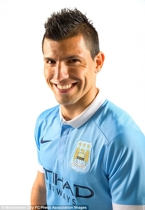 Sergio Aguero grins while wearing the new City kit