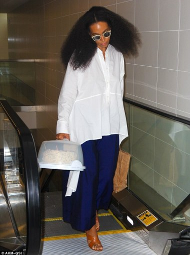 Sweet treat: Solange Knowles carried a cake as she walked through LAX on Friday to take a flight out of LA