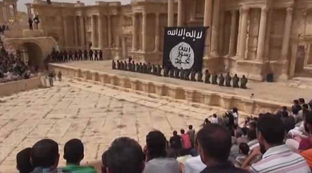 Waiting crowd: Earlier this month ISIS released an execution video from inside Palmyra, showing 25 child executioners lining up regime soldiers in a Roman amphitheatre and shooting them in the head