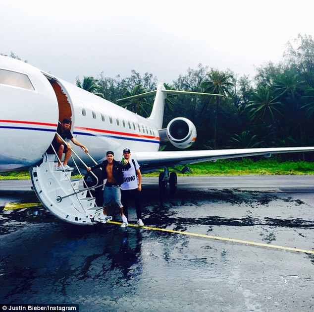 Let loose: Justin posted a photo of himself holding a bottle beer before boarding a private jet on Saturday with Joe and his spiritual adviser, Pastor Joel Houston