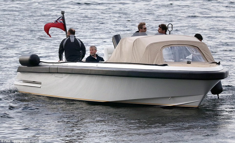 Low key: Roman Abramovich was seen arriving on the Isle of Arran this morning, brought ashore in a 20ft launch with a group of friends