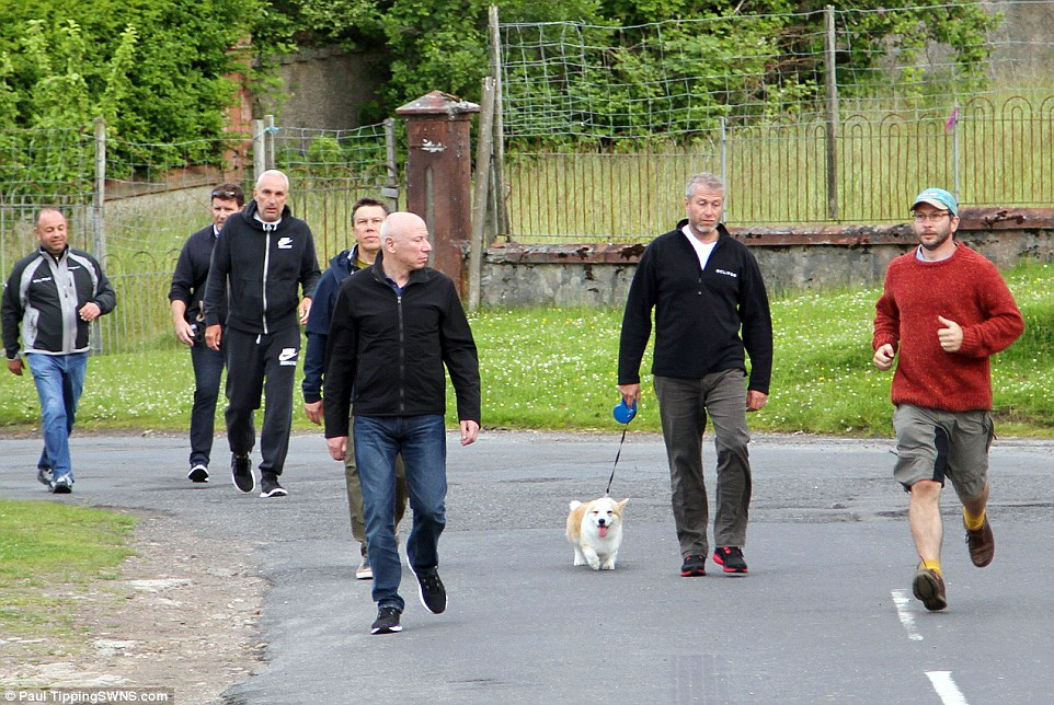 Entourage: Mr Abramovich has been accompanied throughout his travels with the small dog which locals described as being 'very cute'