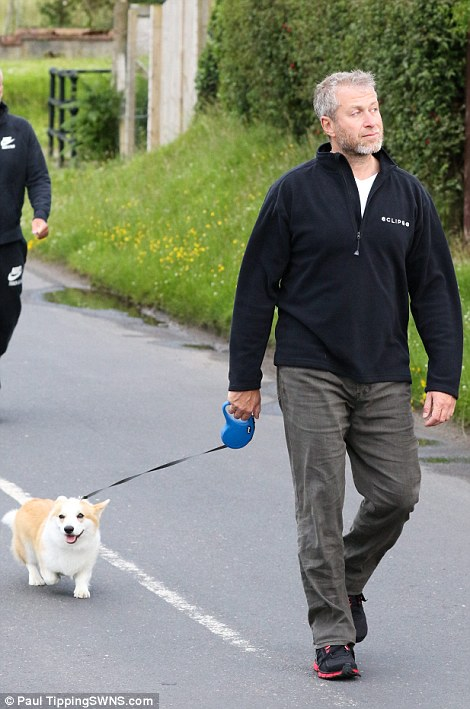 Mr Abramovich was seen doting on his dog on Monday