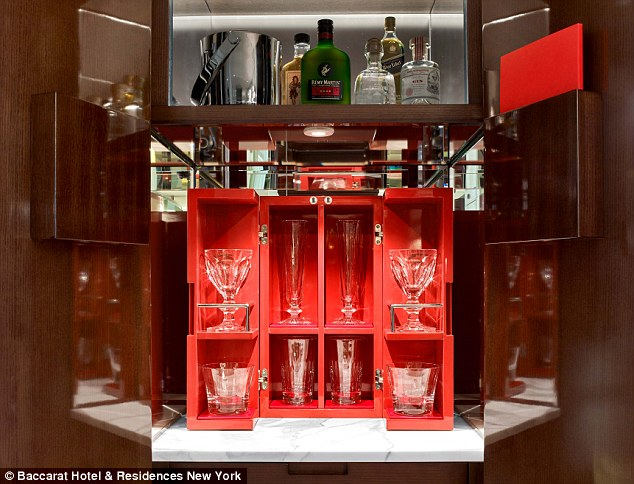 At the Baccarat Hotel & Residences in New York, the in-room bar offering is anything but mini. All of the premium liquor bottles are full-sized and the snacks are imported from France