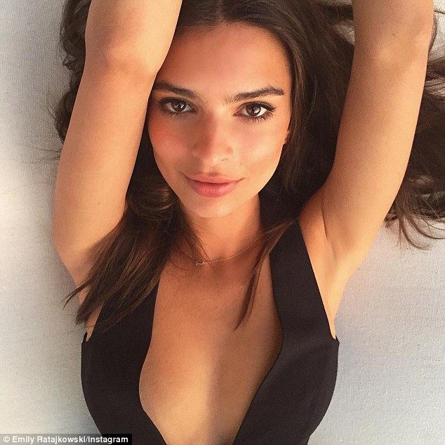 Taking the plunge: Dressed in a plunging black number, the 24-year-old proudly drew attention to her ample cleavage and flashed a hint of sideboob as she pulled a variety of poses