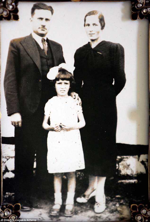 Slaughter: Mrs Nikolaou-Sfountouri was 11 when her parents (Miltiadas and Condelia, pictured with her in 1940), grandparents and two younger sisters were murdered by Nazi soldiers in the massacre