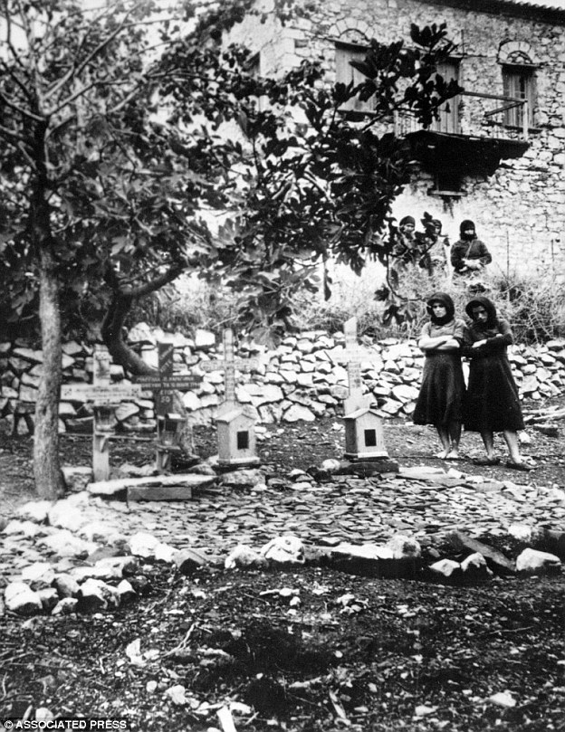 Revenge: Women standing In the graveyard of Distomo, Greece, where victims of a 1944 Nazi massacre are buried. The attack was punishment for an attack by partisans