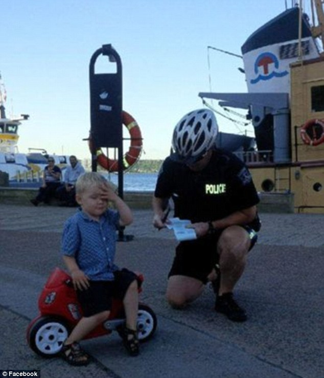 Declan Tramley, 3, may not have his license yet - but he knew exactly how to react when he got written up for his first 'ticket' at a ferry terminal's no-parking zone in Halifax, Canada