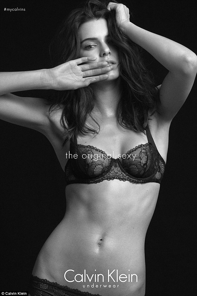 Oh my! In another photo Kendall shows off her washboard stomach in a bra and knicker set