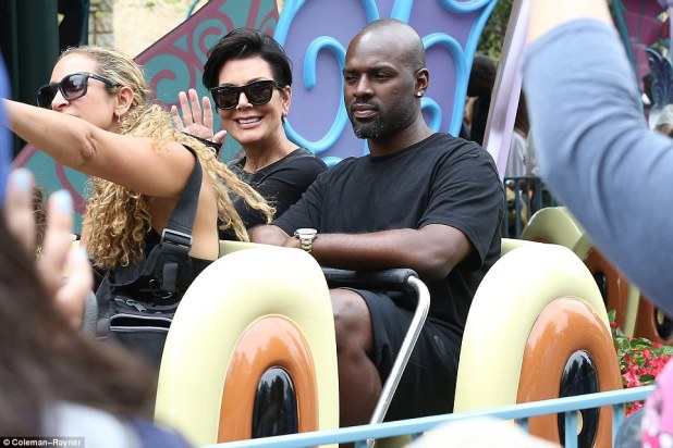 Not really into it: Although Kris couldn't stop smiling, Corey didn't appear to be enjoying his Disneyland experience quite so much