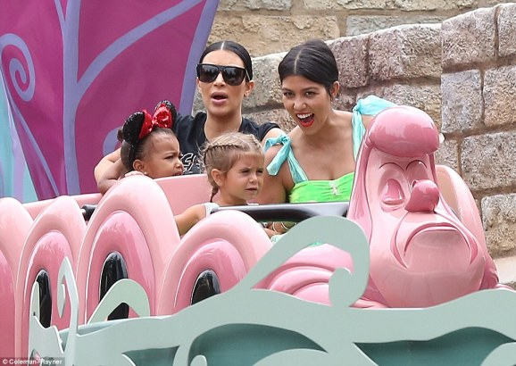 Leaving her problems behind: Kourtney Kardashian took her daughter Penelope to Disneyland on Wednesday to celebrate her third birthday just days after news broke that she has split with Scott Disick, and Kim and North came too