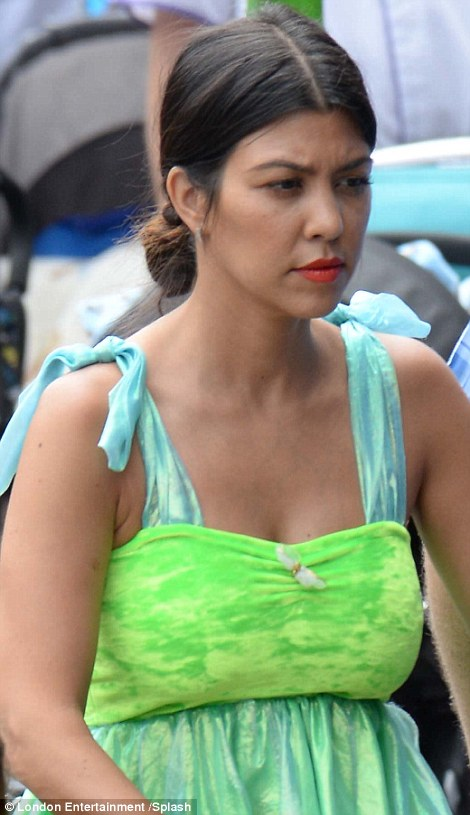 In the spirit: Kourtney and Penelope wore matching cute Tinkerbell-inspired number for the outing but Kourtney appeared pensive at times following her sad split