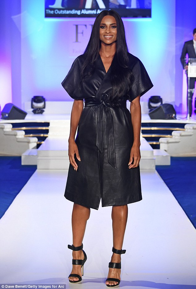 Working that runway: The 29-year-old singer ensured she was dressed to impress for the occasion, opting for high-fashion glamour in a black leather kimono-style wrap dress