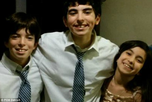 Put in detention: Judge Lisa Gorcyca has sent Liam Tsimhoni (center), 14, and his siblings Roee (left), 10, and Natalie (right), nine, to a juvenile detention center after they refused to have lunch or speak to their father