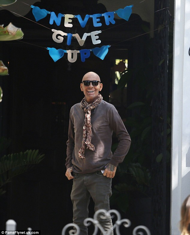 Inspirational: Back in April, Christian was in good spits as he left the Cedars-Sinai Hospital celebrating in front of a sign with 'never give up' spelled out on it