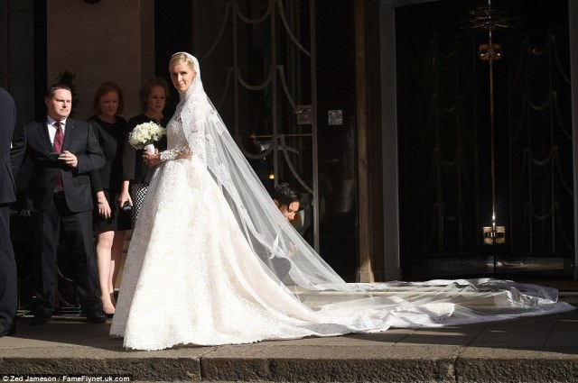 Stunning: Miss Hilton looked radiant as she prepared to marry billionaire banking heir James Rothschild