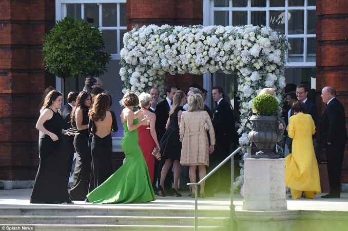 Under the arch: Guests enjoy the day with no expense spared as they watch the heir and heiress tie the know at Kensington Palace