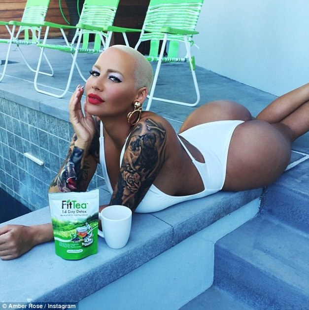 Bootilicious: Amber Rose, 31, paraded her killer body in a seriously skimpy swimsuit as she enjoyed some down time by the pool on Saturday
