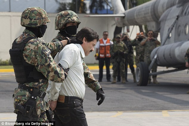 Last time: Pictured are Mexican security forces bundling Guzman into a helicopter after his capture in February 2014. Authorities said there was no chance he would escape again