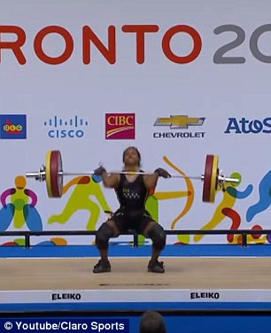 Rodriguez missed her first clean and jerk attempt. She is seen here starting the lift, raising the bar to her shoulders