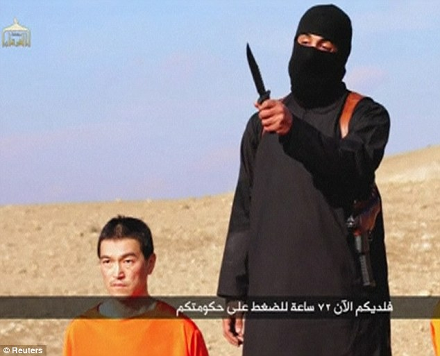'The only thing missing was the orange jumpsuit': Onlookers said the attack recalled an ISIS-style execution like the ones carried out on Japanese hostage Kenji Goto (above)