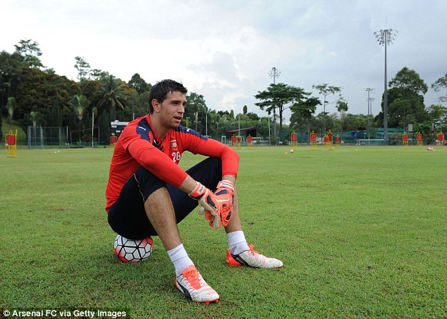 Arsenal goalkeeper Martinez takes a breather in Singapore after being tested heavily during a training session