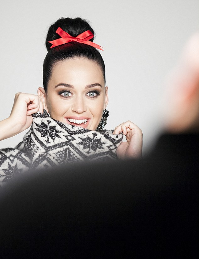 Donning a cosy Christmas jumper and red bow, Katy is the picture of holiday cheer in the behind the scenes imagery released by the Swedish fashion giant