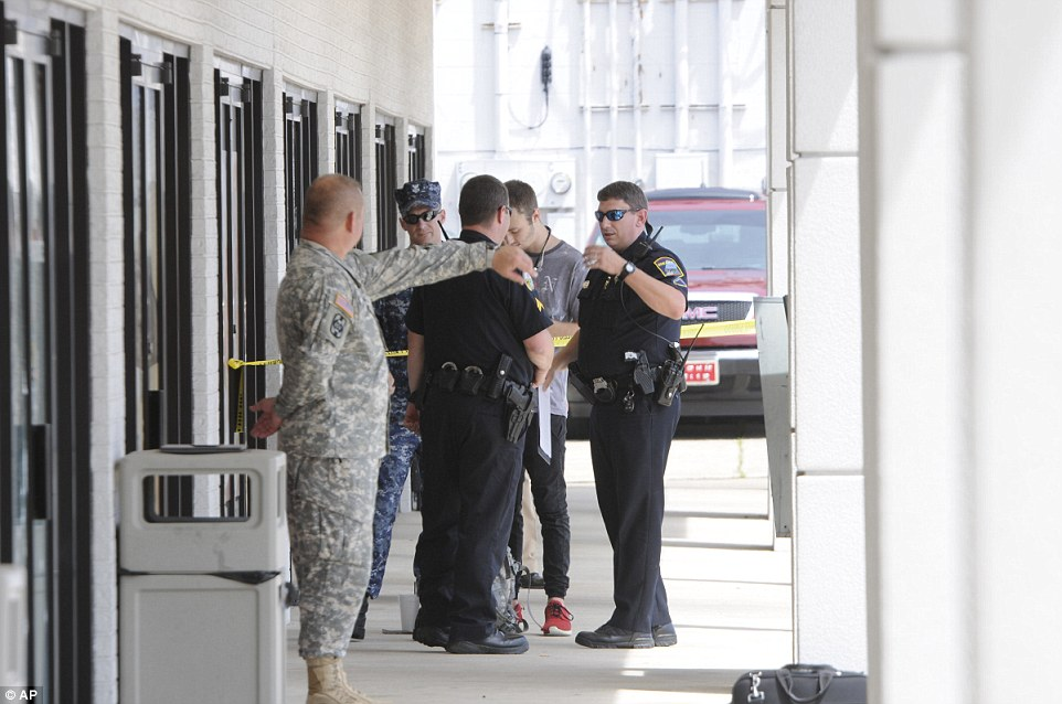 Investigation: Chattanooga police talk to Reserve Recruitment Center personnel at the Lee Hwy office. Two military facilities in Tennessee were attacked in shootings Thursday