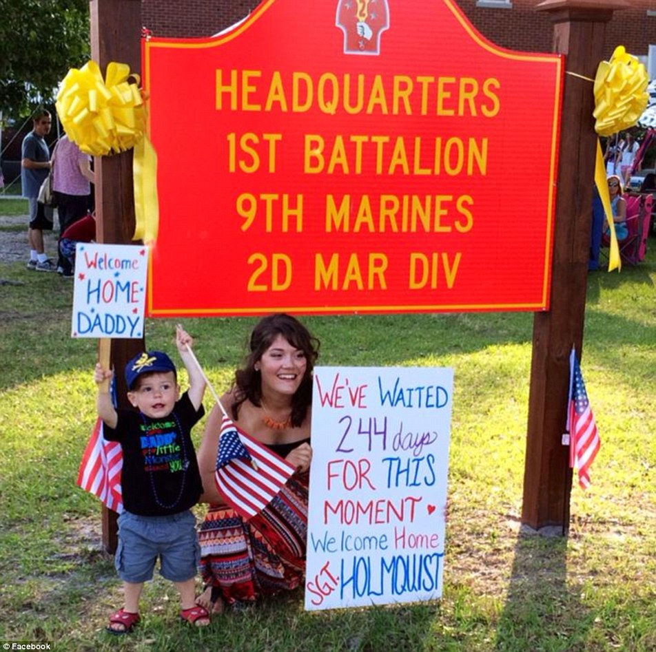 Sgt Holmquist returned from a 244-day deployment with the Marines last year, according to this photo posted to Facebook of his wife and son welcoming him home