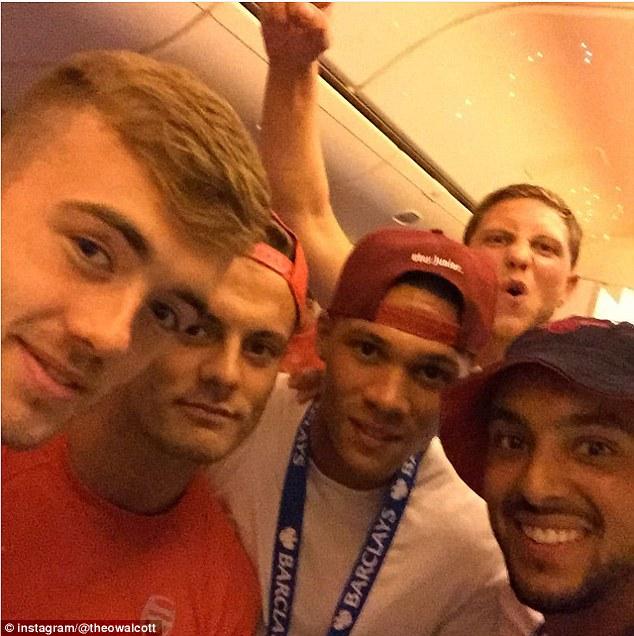 (From left to right) Calum Chambers, Jack Wilshere, Kieran Gibbs and Theo Walcott celebrate Arsenal's win