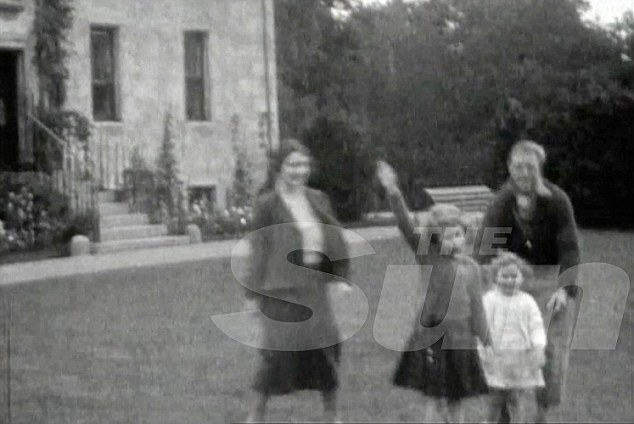 Family film: Edward VIII, long accused of being a Nazi sympathiser, is said to be shown in the footage teaching the salute to the two young sisters. However, a lip reading expert has denied the claims, saying the girls are being asked to wave