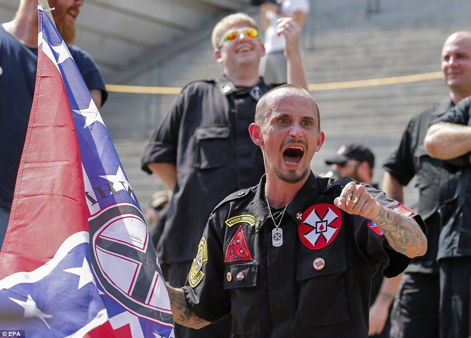 A member of a white supremacist group yells at opposing protesters  during the New Black Panther Party and Ku Klux Klan rallies on the grounds of the South Carolina Capitol in Columbia, where the Confederate flag was taken down from its pole