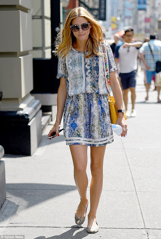 Keeping cool: Fashion icon Olivia Palermo kept cool in a sweet mini while running errands in New York Monday