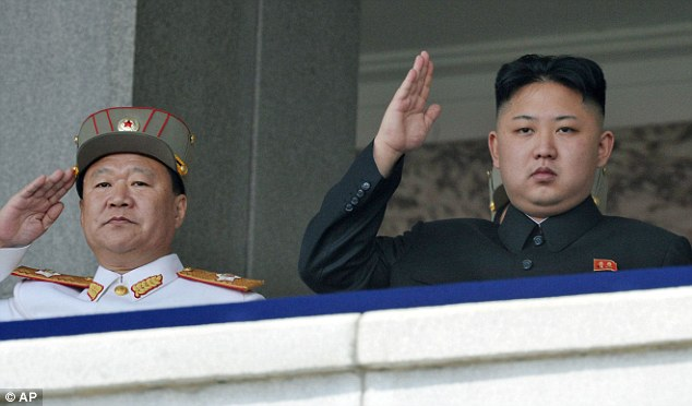North Korean leader Kim Jong Un and Vice Marshal Choe Ryong Hae salute during a mass military parade in Kim Il Sung Square in April 2012 to celebrate the centenary of the birth of his grandfather Kim Il Sung in