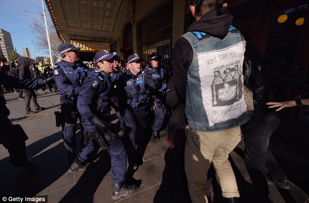 A group of police set upon an anti-racism protester as tensions rise at the controversial rally