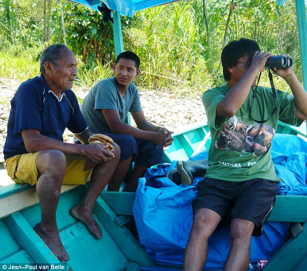 Pictured:Shaco Flores, a Matsigenka Indian, (pictured far left) is believed he was killed for trying to persuade the tribe to give up their nomadic way of life