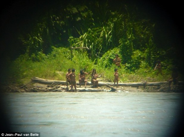 Unknown: These amazing pictures show the group on the bank of the Madre de Dios river where they are tempted in the dry season to camp and find turtle eggs