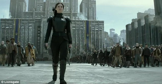 Follow th leader: The clip shows Katniss walking up the central boulevard in the Capitol as thousands of citizens fall in behind her