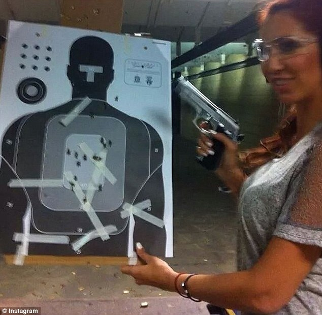 Shooting range: In her Instagram and Facebook pictures, Pikula can be seen striking seductive poses in an array of bikinis and engaging in glamorous activities. In the above shot, she wields a gun at a shooting range