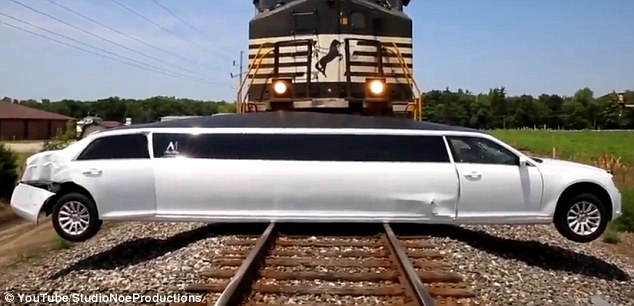 The limo was sprawled out across the tracks with damaged chassis