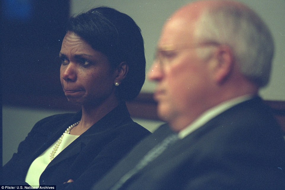 Looking worried: Rice bites her lip as she sits beside Cheney in the PEOC. While the officials were inside the underground bunker, first built for President Franklin Roosevelt in World War Two, there were  reports of more hijacked planes heading toward the White House
