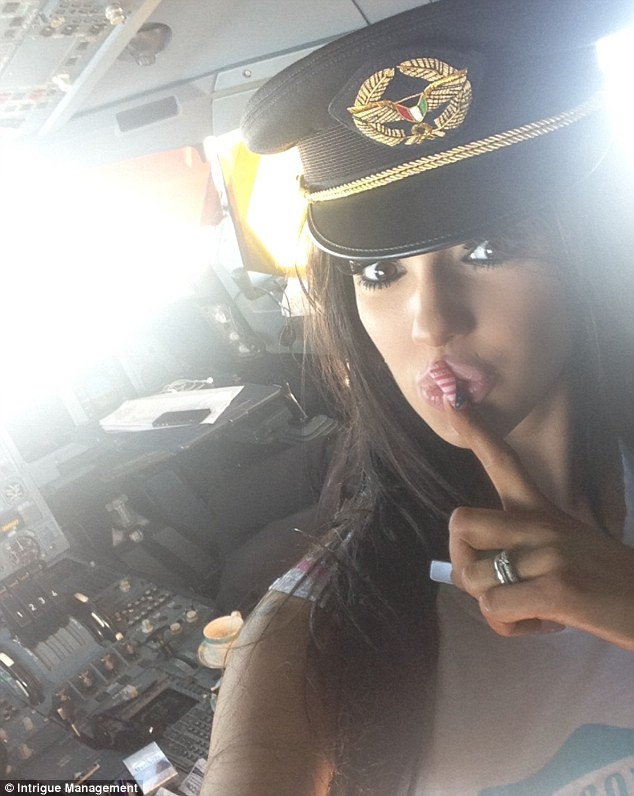 'Naughty' captain: Glamour modelChloe Mafia is pictured in the cockpit of a plane after the pilot invited her in and asked her to sit on his knee as he flew the aircraft