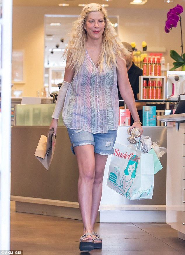Retail therapy: The Beverly Hills, 90210 alum appeared to have had a successful shopping day as she walked out of the store with multiple bags in her hands