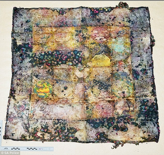 When SA Police released this image of this badly degraded but colourful quilt found with the child's body, quilters quickly went to work identifying seven of the fabrics used in the hexagonal patches, including the 'musical note' material in the border which was sold at Spotlight fabric outlet some years ago