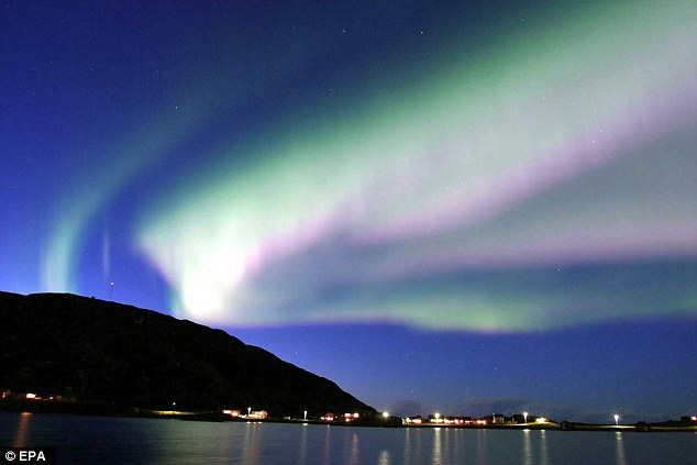 Aurora Borealis, also known as the northern lights, like those shown above Norway, are caused by the flow of electrically charged particle that are thrown out by the sun during solar storms. Solar events like the one that caused this aurora are relatively minor compared to the one that hit the Earth in 1859