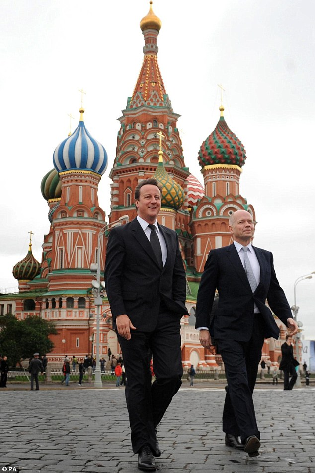 Untrue: But today the Kremlin said the two 'agents' Mr Cameron thought were Russian spies were in fact just a pair of dodgy salesmen. The Prime Minister is pictured in Red Square in Moscow with William Hague