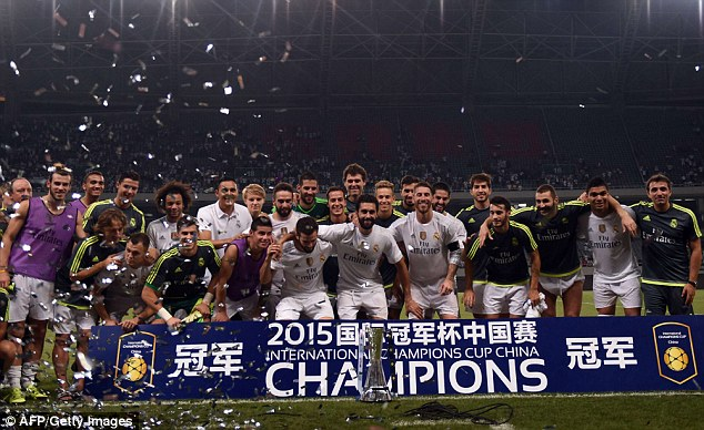 Real Madrid players celebrate with the International Champions Cup trophy in Shanghai